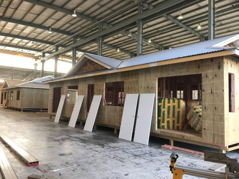 Manor Build house being built inside of a factory
