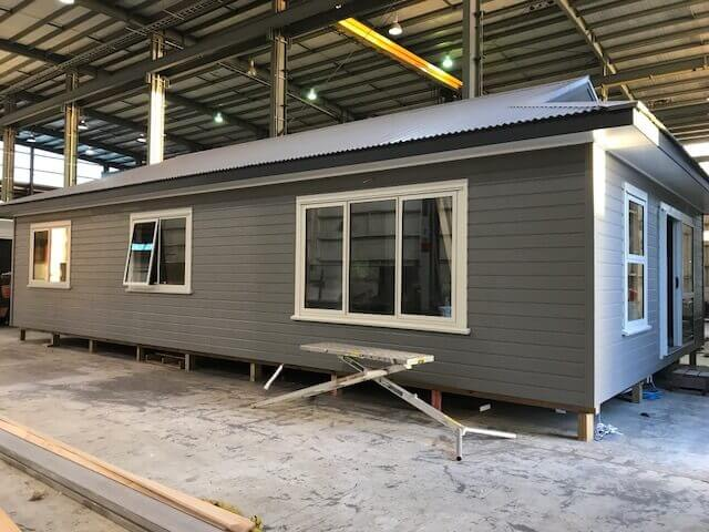 Prefab home being constructed in environmentally controlled conditions