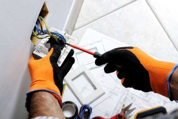 Who does the electrical wiring in a prefab home